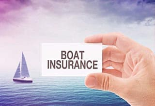 sailboat in the ocean and boat insurance card
